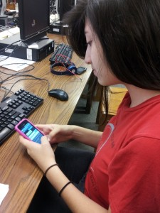 Sophomore Sheila Aguilar texting on her phone