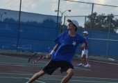 Senior Alonso Fernandez runs back to return a ball going over his head. He won his singles match against his LBJ opponent in the dual match at McCallum Sept. 16.