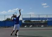 Junior Connor Teseny serves in his singles match against his LBJ opponent.