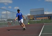 Senior Kyle Teseny, team captain, moves to hit a groundstroke.