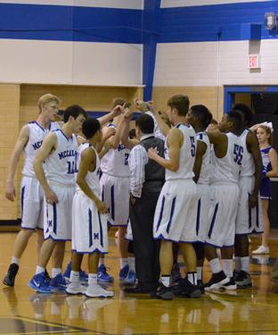 The basketball team huddles at its game against Eastside Memorial Tuesday night. The team won 97-46. Photo by Nick Robertson.