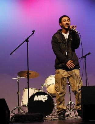 Senior Bomani Barton sings at the Battle of the Bands. The show was a competition between student bands as a fundraiser for the classical guitar program. Photo by Aiden Foster.