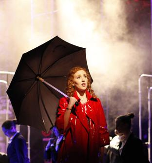 "Sophomore Ellie Zambarano sings in the rain as Molly Jensen in the musical ""Ghost."" The show ran the last two weekends on the MAC stage. Photo by Aiden Foster."