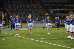 Senior Audrey Holden (center) marches snare at the Taco Shack halftime show.