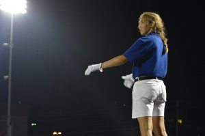 Hannah Wright, a Senior drum major, conducts the band during the Taco Shack halftime show.