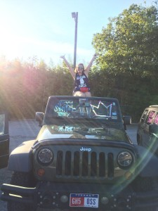 Senior Marley Chilton poses on her decorated car for the first day of school. Photo provided by Chilton.