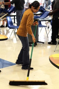 Custodian Maria Mendoza sweeps the cafeteria at the end of lunch.