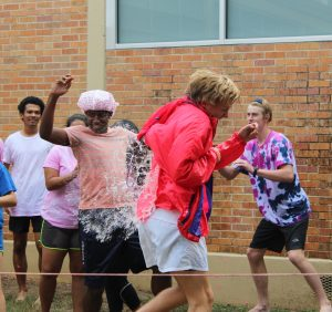 "Senior David Ruwwe takes a water balloon to the back during the PALS annual Pink Week fundraiser ""Peg-a-PAL."" The PALS raised over $1,200 for Breast Cancer research. Photo by Rylie Jones."