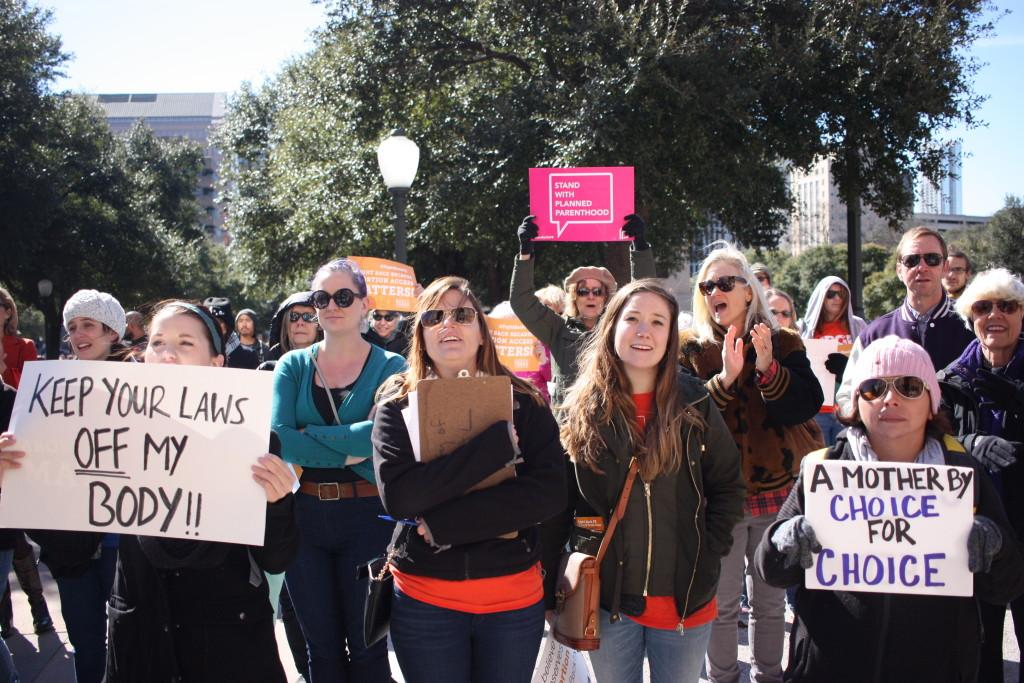 "Diana Silva (bottom right) attended the pro-choice rally commemorating the 43rd anniversary of the Roe v. Wade Supreme Court decision at Texas on Jan. 22. ""Sex ed should be provided for everyone,"" Silva said. ""It's not just about posting on Facebook or social media, it's about doing something about it."" Photo by Ashley Chamberlain."