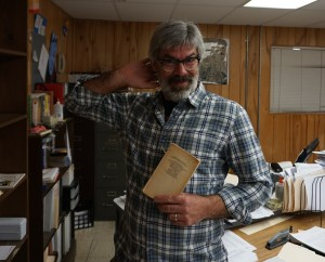 Mr. Wydeven sporting a copy of For Whom the Bell Tolls. Photo by Madison Olsen.