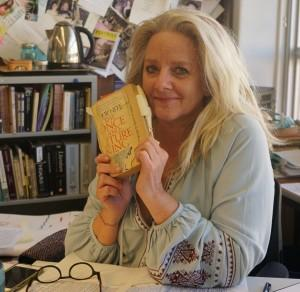 Mrs. Adamson holds her copy of her favorite book. Photo by Madison Olsen.