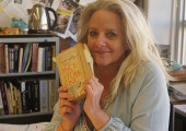 Mrs. Adamson holds her copy of her favorite book. Photo by Madison olsen