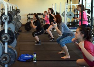 """The volleyball team underwent a hour-long dose of crunching, squatting and kick-boxing during fourth period on Jan. 9 in a Zumba routine choreographed by the team. The team suffered all the planning and pain in order to stay in shape and to practice endurance. Coach Northcutt said at the beginning of class: """"This will probably last us for the rest of the week."""" Photo by Brooke Miller."""