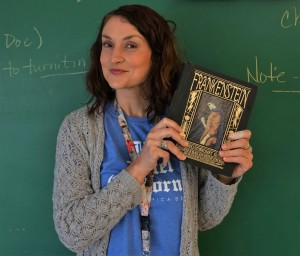 Ms. Northcutt holds her copy of Frankenstein. Photo by Madison Olsen.