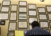 """As he continues to work in sketch up I strike up a conversation about all the framed papers on the wall. Many of them are simple things like bachelor's and master's degrees while most are awards for various projects over the years. The only reason he sits with them in front of him is that it was the only wall big enough to hold them all. """"I would never take credit for an award but I would like to think I was influential in some."""""""