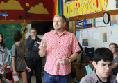 Tim Bjerke gives instructions for a notecard activity at a McCallum Christian Community and Spectrum joint meeting on May 4 in his classroom. Students wrote a time they had been discriminated against on one side of the card and a time they had acted in a hateful way on the other side of the card before sharing with their peers. Photo by Madison Olsen.