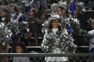 Senior Ariella Dos Santos cheers on the football team during a game at House Park last fall. Photo by Brooke Miller.