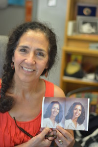 Lucia Facundo, who came to Mac in 1977, hold up her staff photo from the 1982-1983 school year. Photo by Dave Winter.