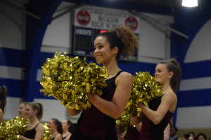 Dos Santos flashes a smile at the crowd during the second annual spring sports pep rally in the gym on Feb. 3. Photo by Dave Winter.