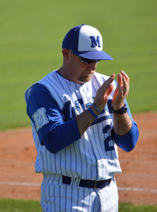 Coach Houston encourages a batter during McCallum's victory over LBJ in March. Photo by Dave Winter.