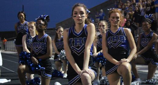 """The cheerleaders kneeling during the national anthem in the game against LBJ High School, the first time they executed the protest. """"We have a president that want's us to be fired for free speech, and that has the nerve to, not directly, but still mention NFL players trying to peacefully protest as 'sons of bitches', when there were literally Nazis roaming in the streets and he called them 'good people',"""" senior Angelina Coleman said. """"That's completely ridiculous to me, and I feel like for a lot of people it was the final straw. We were trying to hold out for this country, we were trying to be respectful of what others feel about that flag…. but [now] I'm not gonna sit around and pretend that everything's okay and put my hand on my heart like this the land of the free, because it's not."""""""