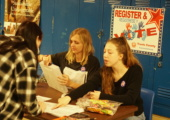 Seniors Roxy Smith and Ruby Dietz register voters outside Ms. Carrasco's hallway on Tuesday, exactly one week after many seniors cast their first ballots in the election that determined the fate of the $1.05 billion AISD bond.  It passed. Photo by Will Tyree.