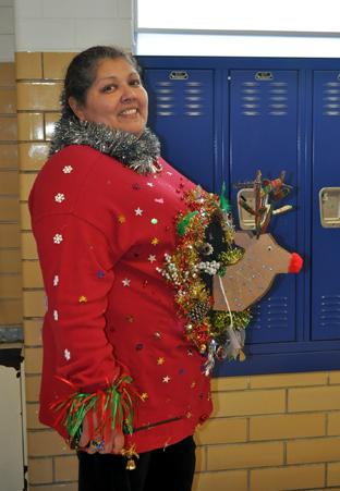 Security Officer Georgia Peña shows off her sweater for the annual tacky holiday sweater contest. She won second place. Photo by Haley Hegefeld.