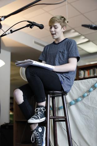 "Sophomore Emerald Ferrel recites her poem ""varos"" at Excalibur's Coffeehouse Thursday. Photo by Aiden Foster."