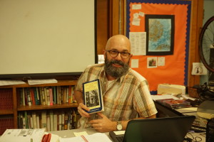Mr. Watterson poses with his favorite book. Photo by Madison Olsen.